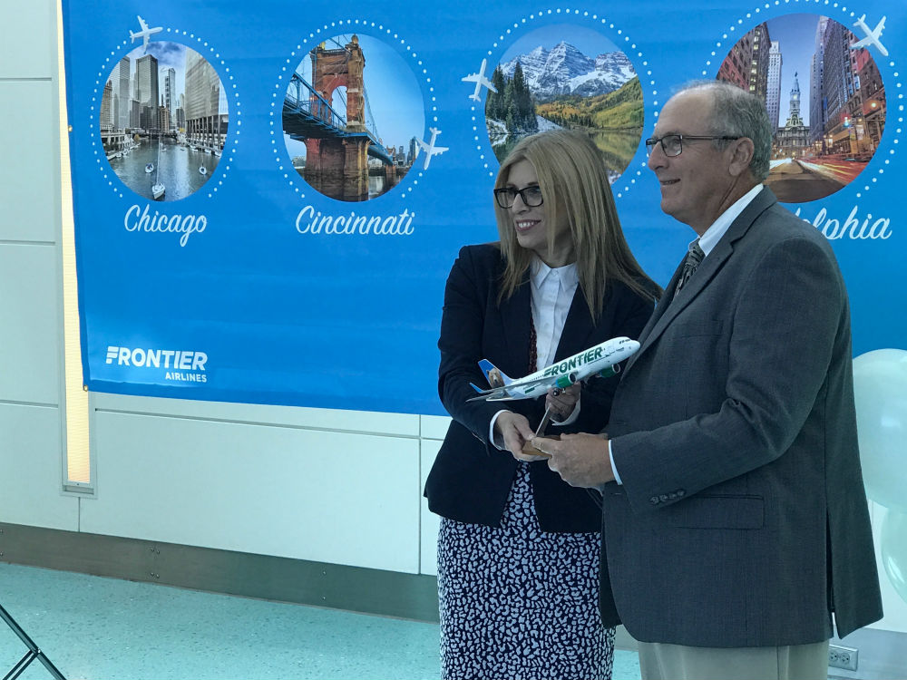Tyri Squyres (left), vice president of marketing for Frontier Airlines and Jacksonville Aviation Authority CEO Steve Grossman at a press conference promoting Frontier's new service